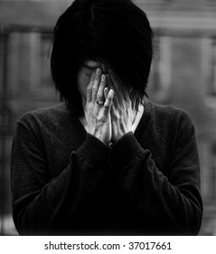 Asian man covered eyes with hands