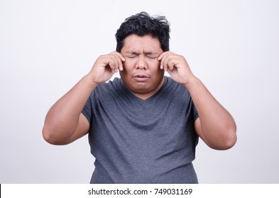 Asian man with crying face
