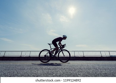 Asian man cycling road bike in the morning