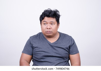 Asian man with disgusted face