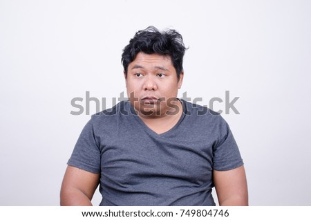 asian man disgusted face stock photo edit now 749804746 shutterstock