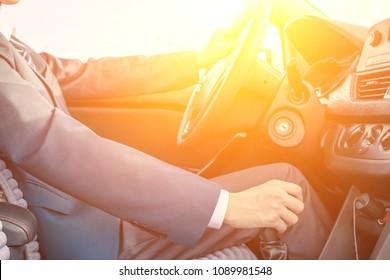 Asian man driving a car