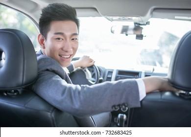 Asian man driving car