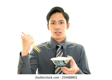 Asian man eating food