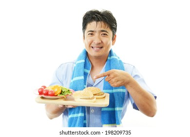 Asian man eating meals