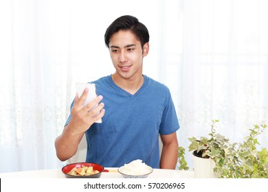 Asian man eating meals
