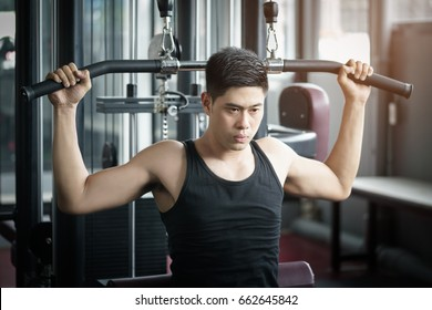 Asian man exercise in  fitness center.