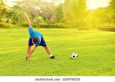 Asian man exercise in garden