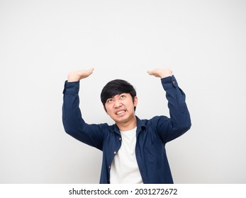 Asian man gesture carry something serious face,Asian man gesture carry product on his head white background