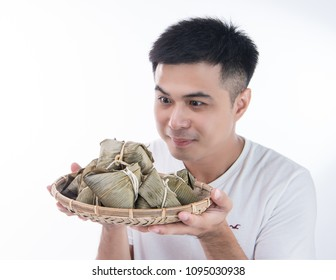 Asian man is giving zongzi (rice dumpling) to others as a present on Dragon Boat Festival, Asian traditional food, white background