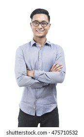 Asian man in glasses isolated portrait. He is standing with arms folded against white background. Concept of successful businessman.