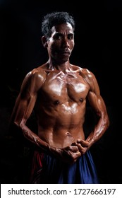 Asian Man with great muscle isolated on black Praya,West Nusa Tenggara/ Indonesia - March 13 2019