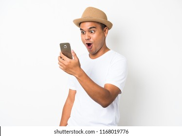 Asian man happy with his smartphone on white background.