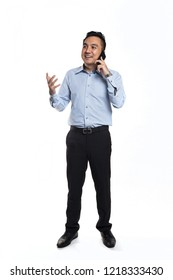 Asian man happy while talking over the phone