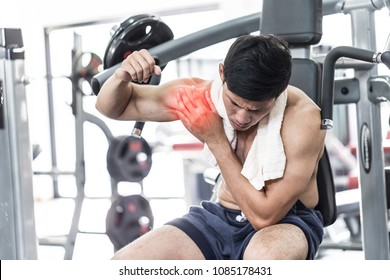 Asian man have injury muscle joint between shoulder and arm pain after workout in gym,Healthcare concept