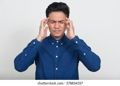 Asian man having headache
