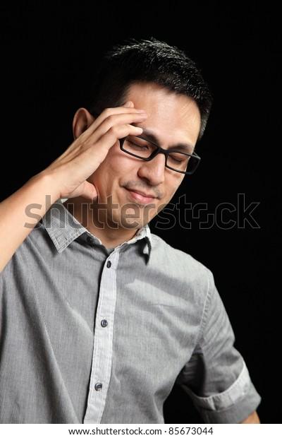 Asian man having a headache
