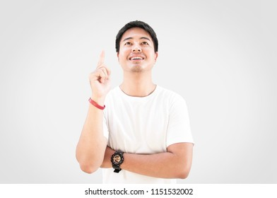 Asian man having new ideas, Successful man smiling, Makes gesture with index finger
