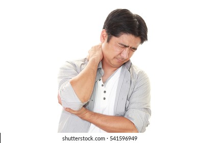 Asian man having a shoulder pain