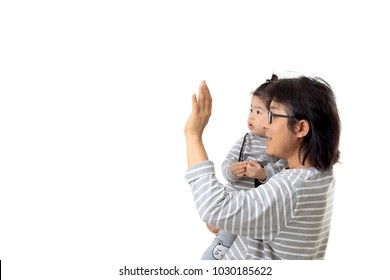 The Asian man with his daughter on the white background.