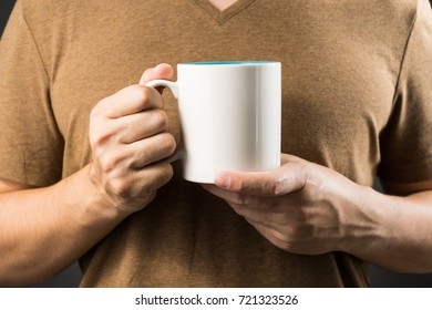 asian man holding coffee mug with copy space for your text