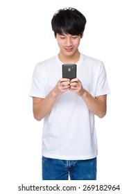Asian man holding smart phone