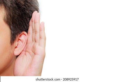 Asian man holds his hand near his ear and listening