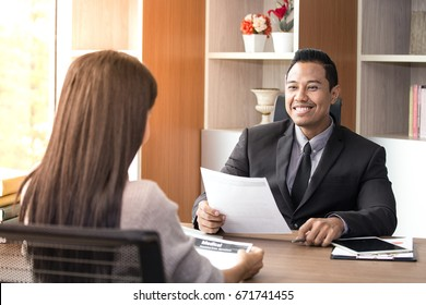 Asian man interview woman for job register with happy emotion.