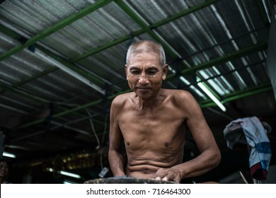 asian man with knife