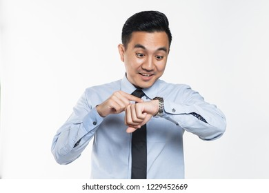 Asian man looking at his wrist watch