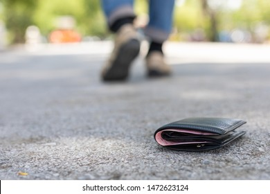 Asian man lose black wallet on the road in tourist attraction. Losing wallet concept