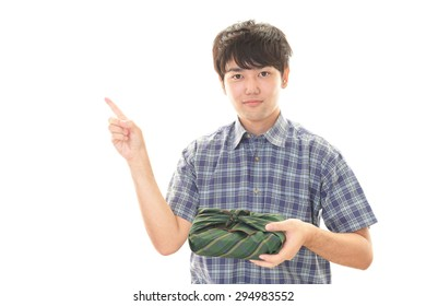 Asian man with lunch box