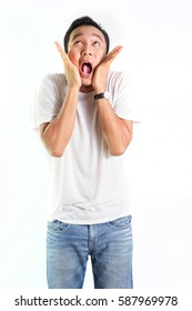 Asian Man is Making crazy face. Funny face of Asian man