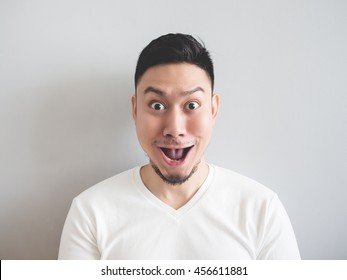 Asian man making very funny surprised face.