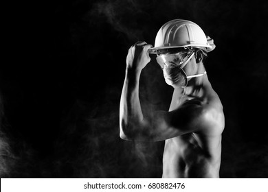 Asian Man naked top body and wear safety equipment to protect from dust and smoke, black and white concept. safe hard hat, protective goggle, chemical mask filter, turn left copy space