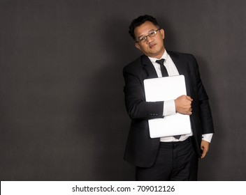 Asian man with notebook.