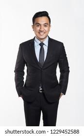 Asian man in office suit posing