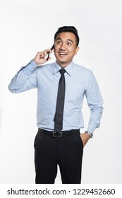 Asian man in office wear using his phone
