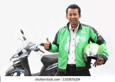 asian man owner driver gojek, grab or taxi online with hand thumb up. Yogyakarta Indonesia. june 03, 2018