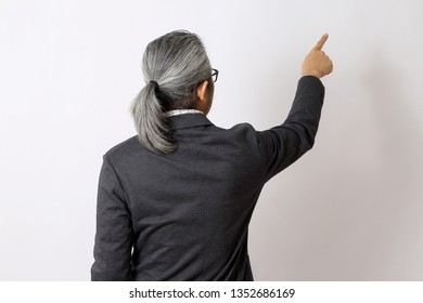 The Asian man pointing in the white space.