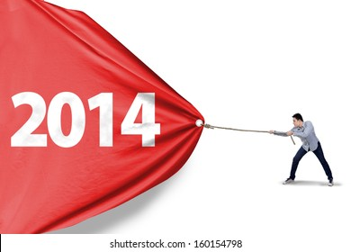 Asian man is pulling new year of 2014 to change the new future