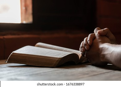 An Asian man is reading the scripture or holy bible. God's teachings according to belief and faith in God. Religion Concept - Image