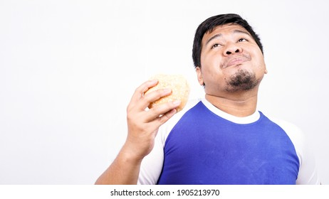 asian man ready to eat burger isolated white background