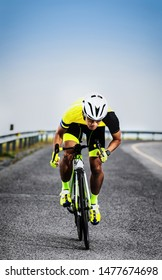 asian man riding bicycle on asphalt road