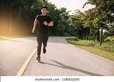 Asian man with runner on the street be running for exercise.