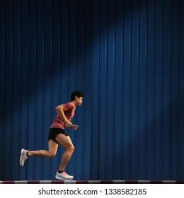 asian man running on sidewalk run, city run concept