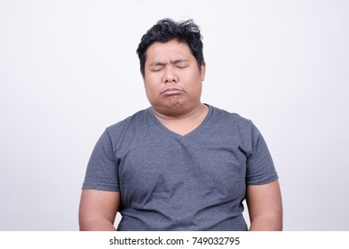 Asian man with serious expression