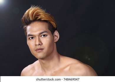 Asian Man sexy face topless male model with Different Shading beautiful gold blonde yellow orange Color Hair, dark gray black background, portrait half body look