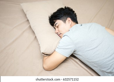 Asian man sleep in bed alone, man sleeping concept, 20s age