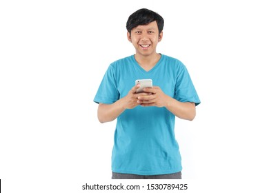 asian man smart phone smiling with blue t-shirt. filipino portrait smiling with smartphone